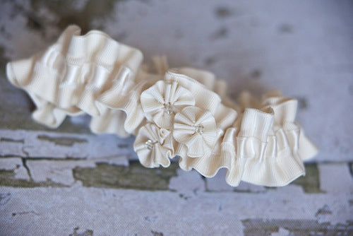 ivory wedding garter with rosettes