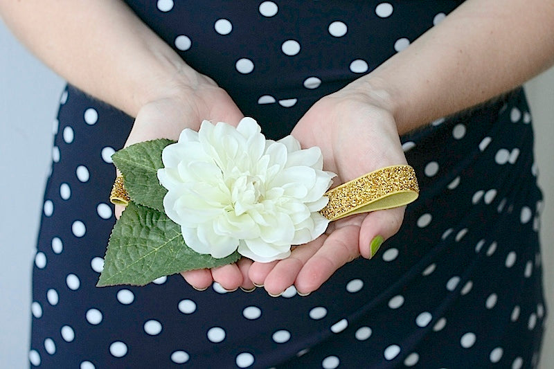bride holding flower wedding garter that she made