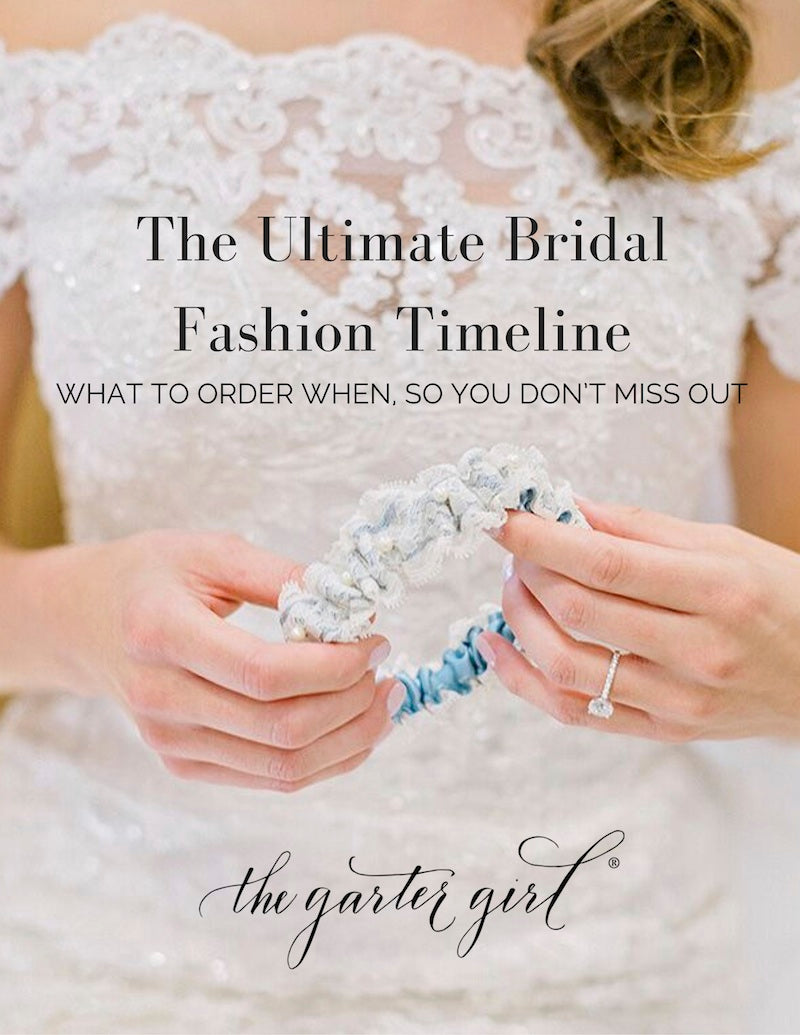 bride holding wedding garter made from grandmothers wedding dress - front cover of ultimate bridal fashion guide