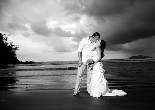 bride-and-groom-on-beach-photo-by-Eduardo-Lopez-Photography