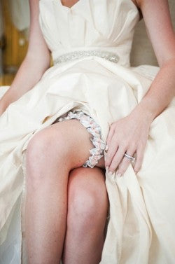 bride-wearing-pretty-wedding-garter-The-Garter-Girl-photo- by-missy-photography