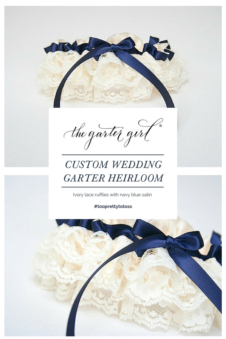 a custom wedding garter design by The Garter Girl with lace and navy blue