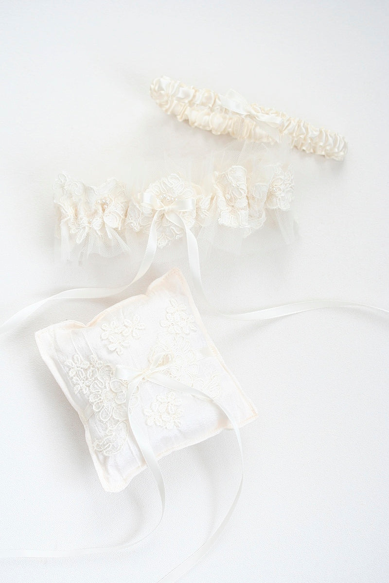 heirloom wedding garter and ring pillow made from mother's wedding dress