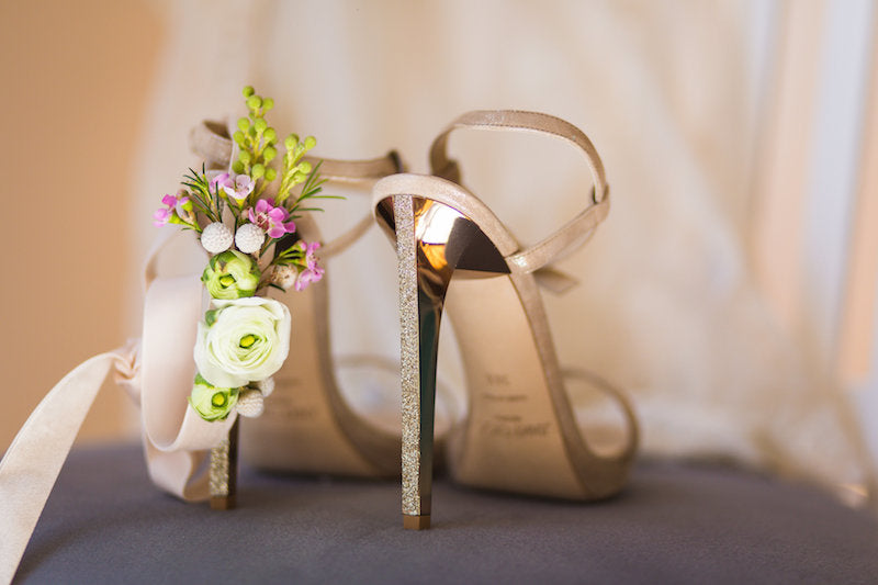 champagne jimmy choo bridal shoes and a fresh flower wedding garter