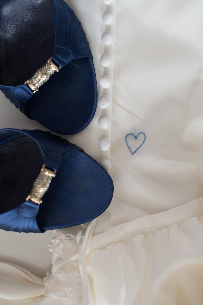 something blue heart sew inside wedding dress and navy blue bridal shoes
