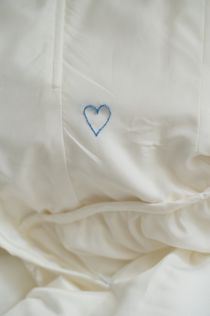 heart sewn on inside of wedding dress