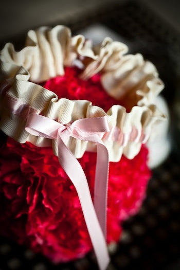 blush and ivory wedding garter on hot pink carnations