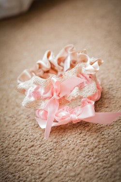 pink-lace-embroidered-wedding-garter-dove-photography