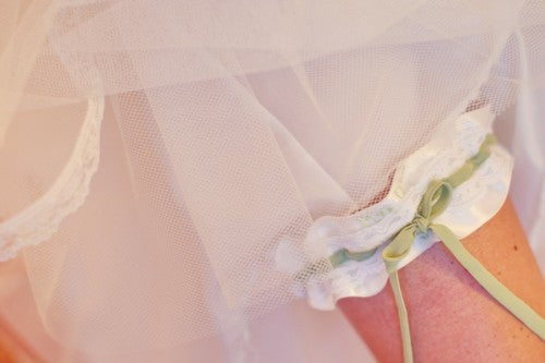 real-white-and-sage-wedding-garter-vanessa-joy-photography