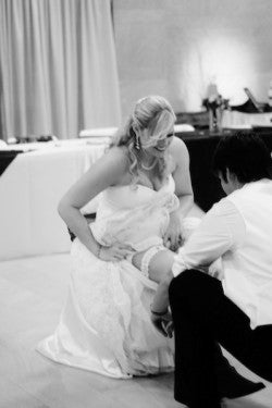sophisticated-wedding-garter-removal-The-Garter-Girl--The-Sutherly-Workshop
