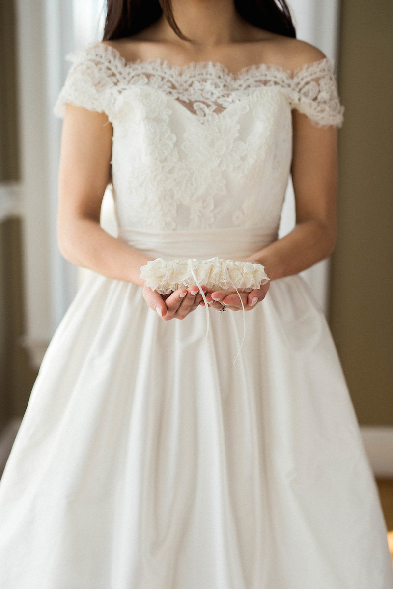 bride in lace wedding dress- when should you order wedding dress