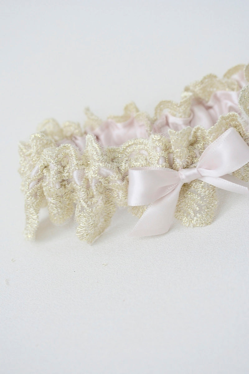 gold lace wedding garter with blush pink satin