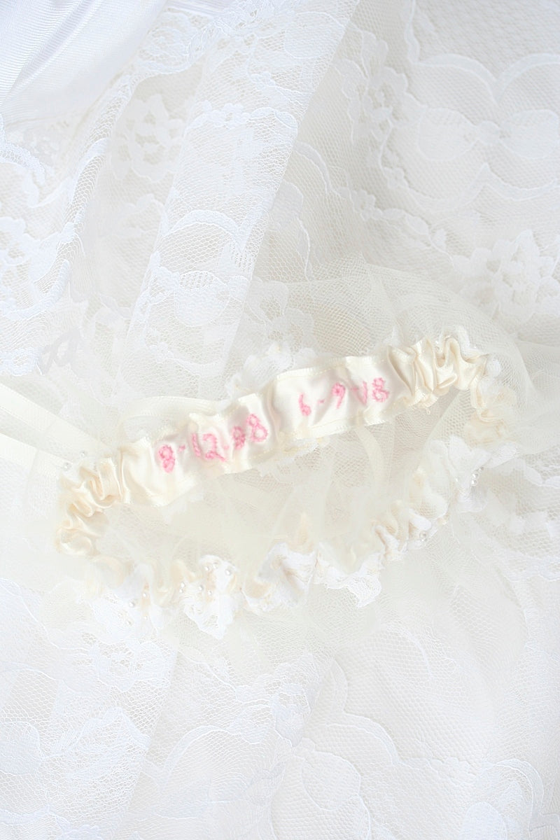 wedding date sewn on inside of wedding garter in blush pink