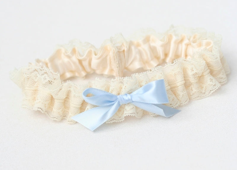 custom bridal garter with lace and blue bow