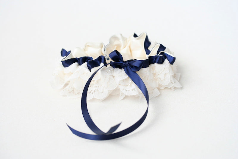 custom garter made from bride's mother's wedding dress with navy blue
