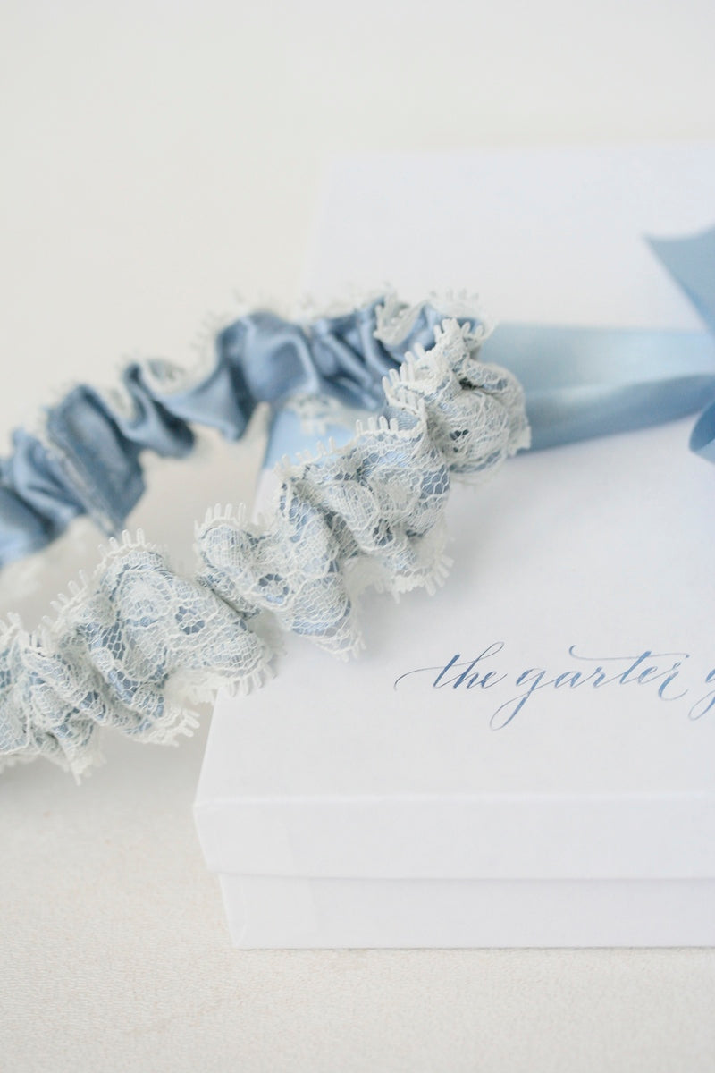dusty blue wedding garter with ivory lace