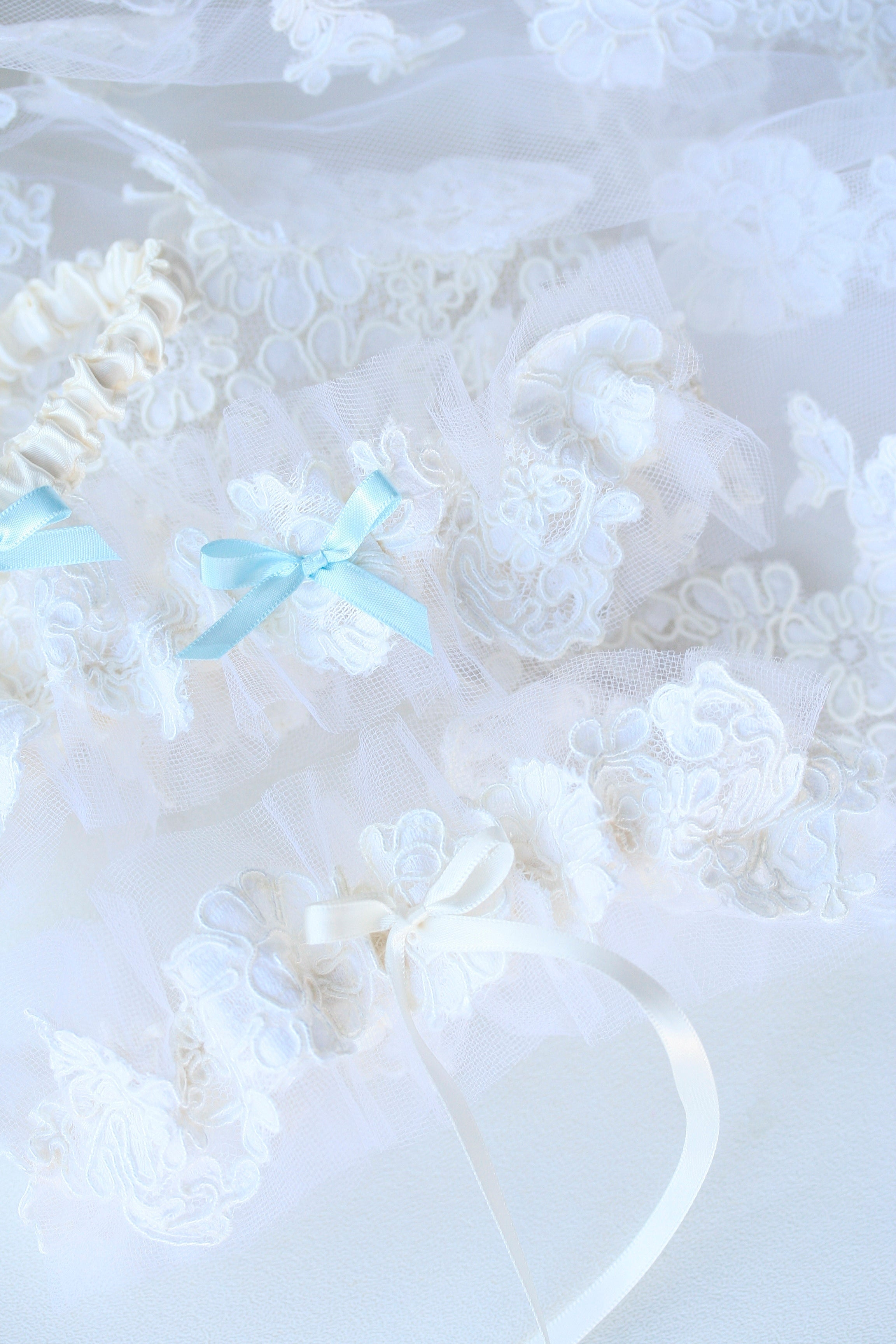 two wedding garters made for two sisters from their mother's wedding veil
