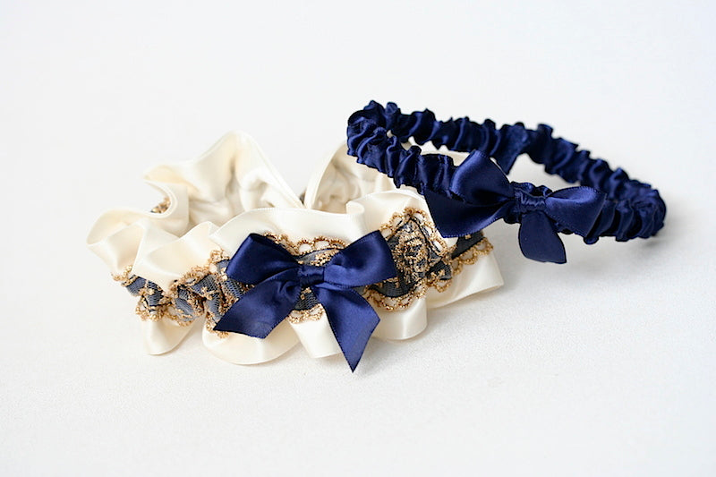 gold lace and navy blue wedding garter set