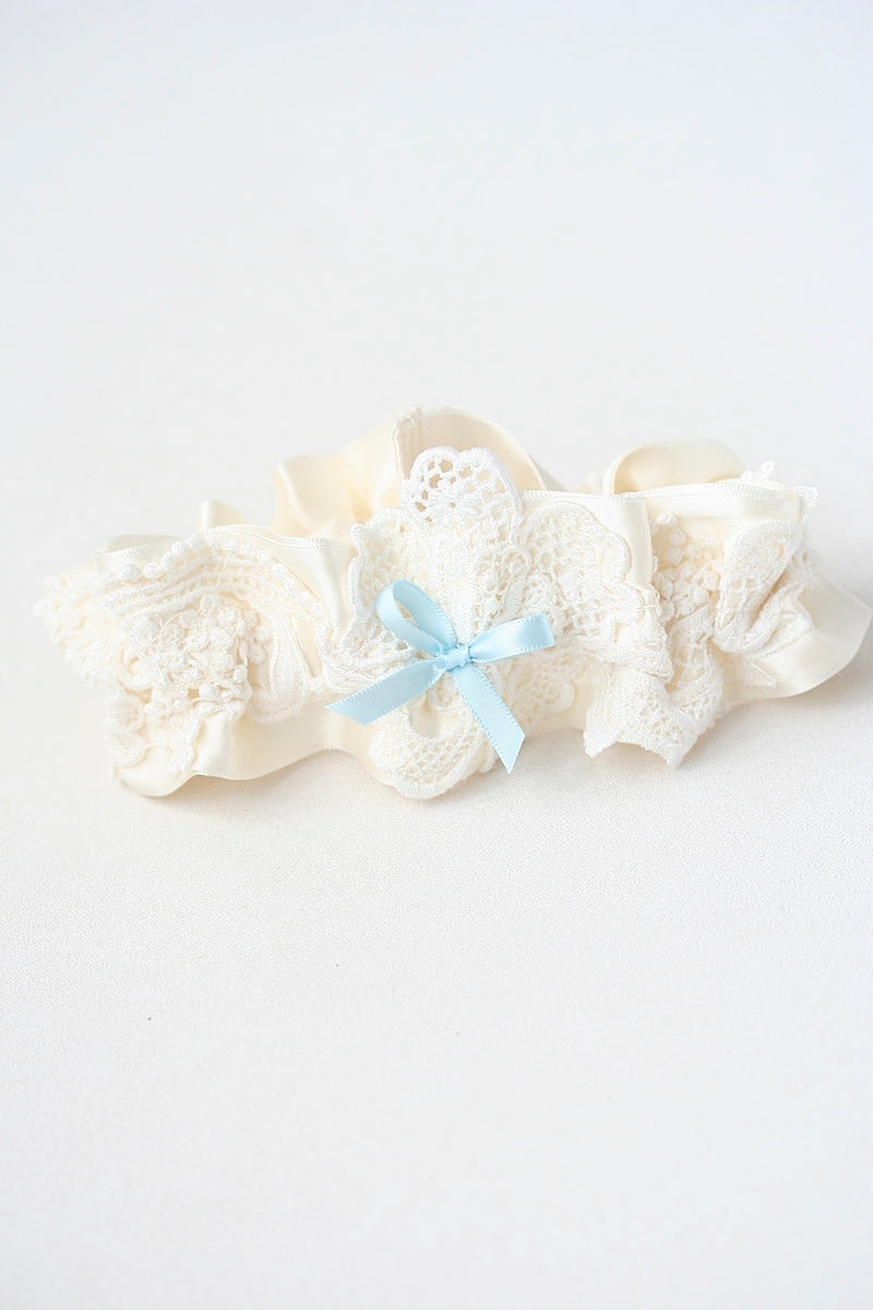 ivory lace wedding garter made from bride's mother's wedding dress with something blue satin bow