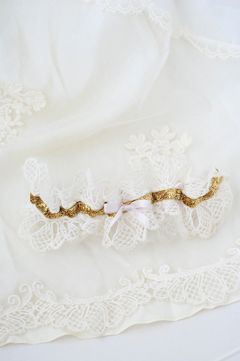 heirloom lace wedding garter with gold glitter and blush