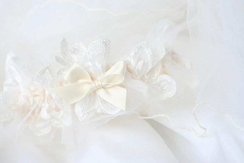 lace wedding garter made from bride's mother's wedding dress