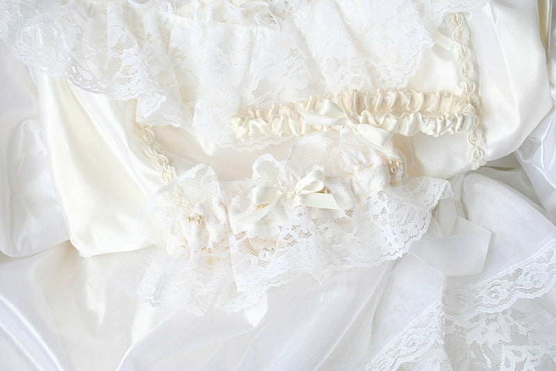 heirloom garter made from mother's wedding dress with pearls and lace