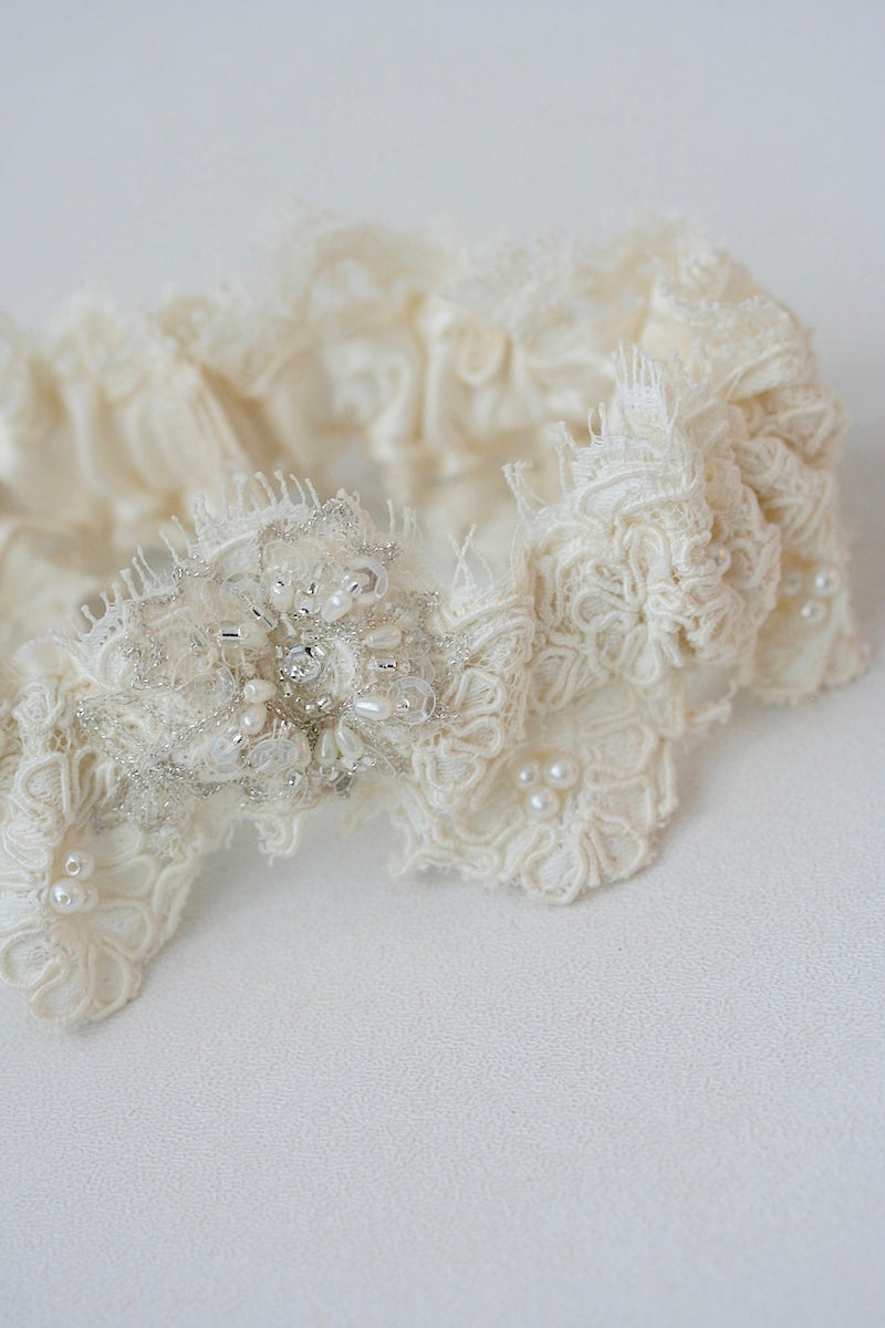 garter with lace taken from mother's wedding dress