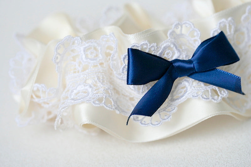 custom wedding garter with ivory lace and navy blue satin bow