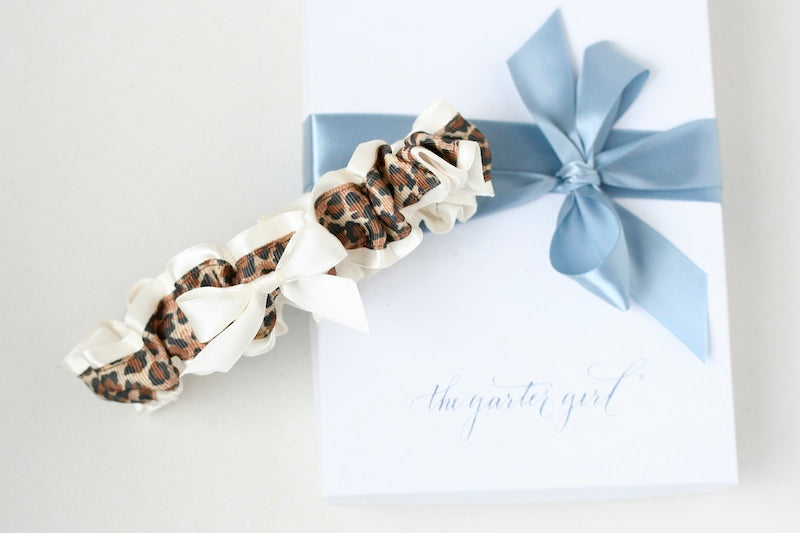 leopard print custom wedding garter with ivory bow