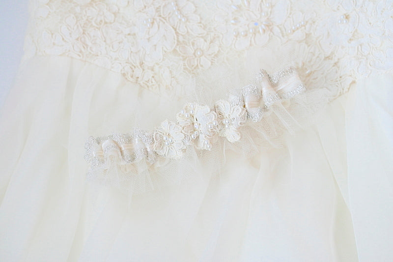 wedding garter made from the bride's mother's wedding dress