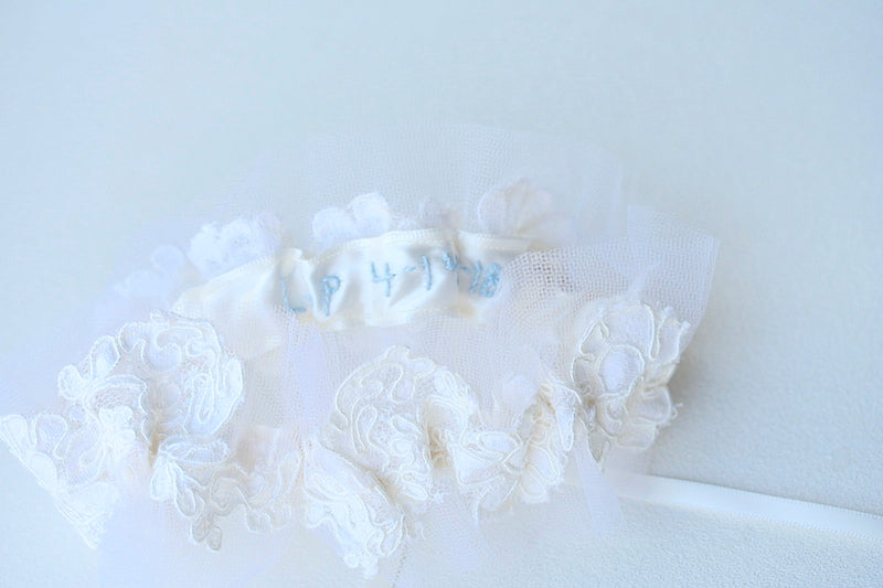 wedding date on inside of lace wedding garter made from bride's mother's wedding veil