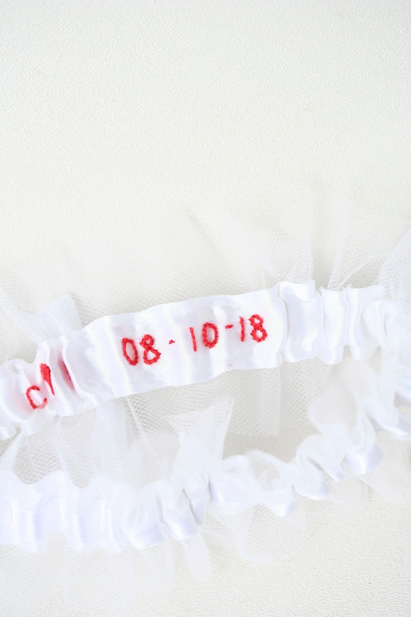 white tulle custom wedding garter with personalized embroidery in red