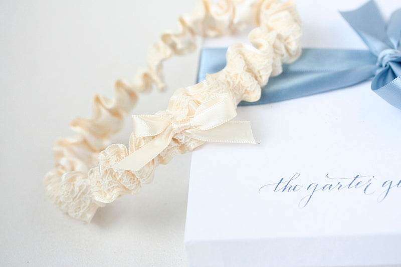 simple ivory wedding garter with lace and satin
