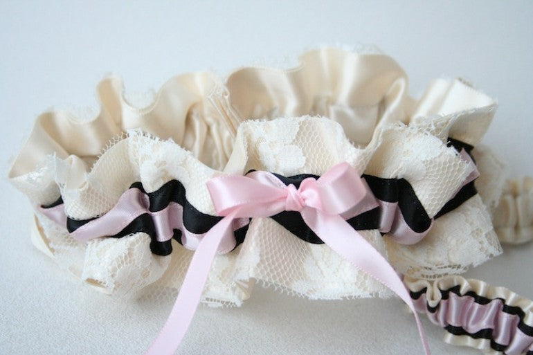 stylish-ivory-lace-with-pink-and-black-wedding-garter-set-the-garter-girl-770x513