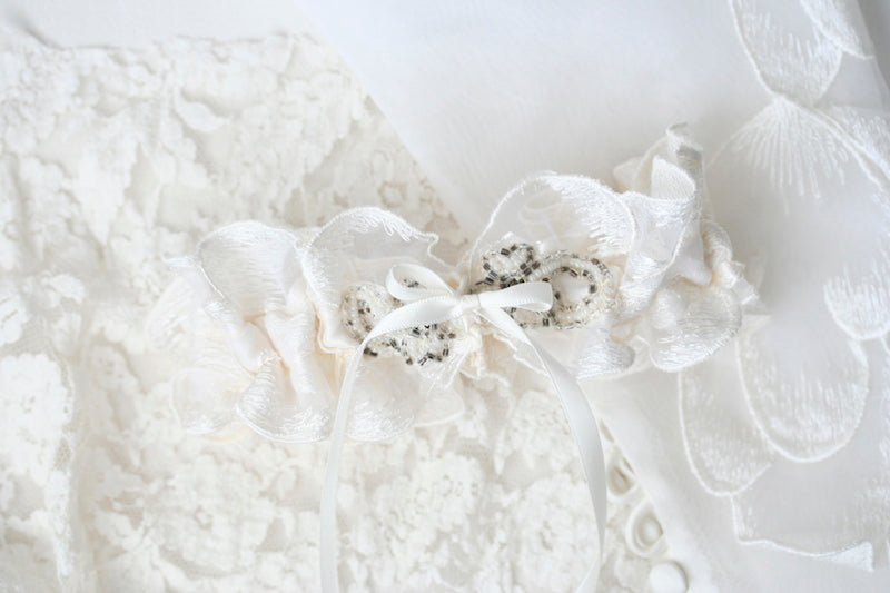 custom wedding garter made from bride's mother's and grandmother's wedding dresses