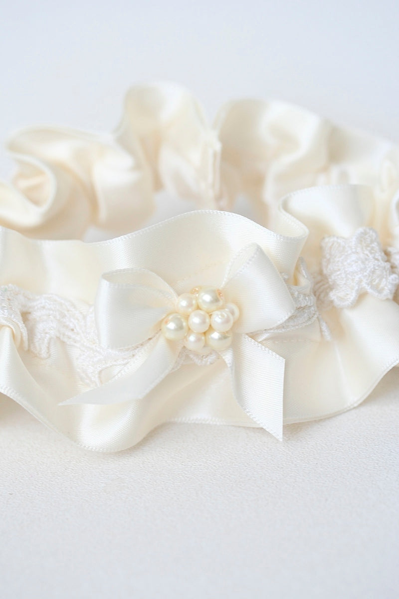 wedding garter made from bride's mother's wedding dress sleeve with lace and pearls