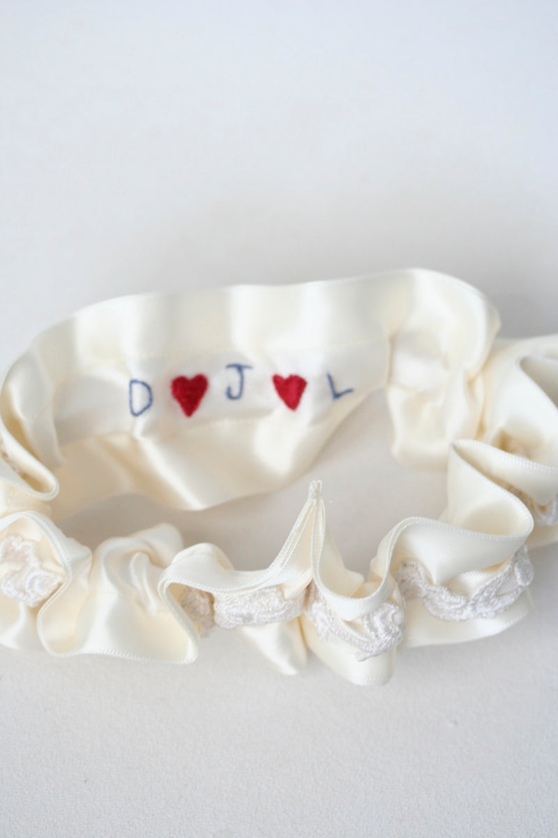 hearts and initials sewn on inside of wedding garter