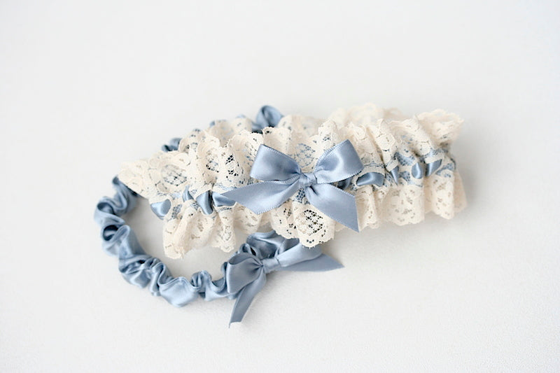 ivory lace wedding garter set with dusty blue satin