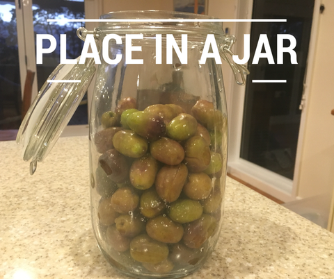 place the olives in the jar