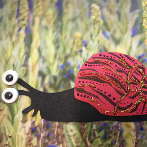 black snail with colourful red shell decorated with gold glitter and black ink.
