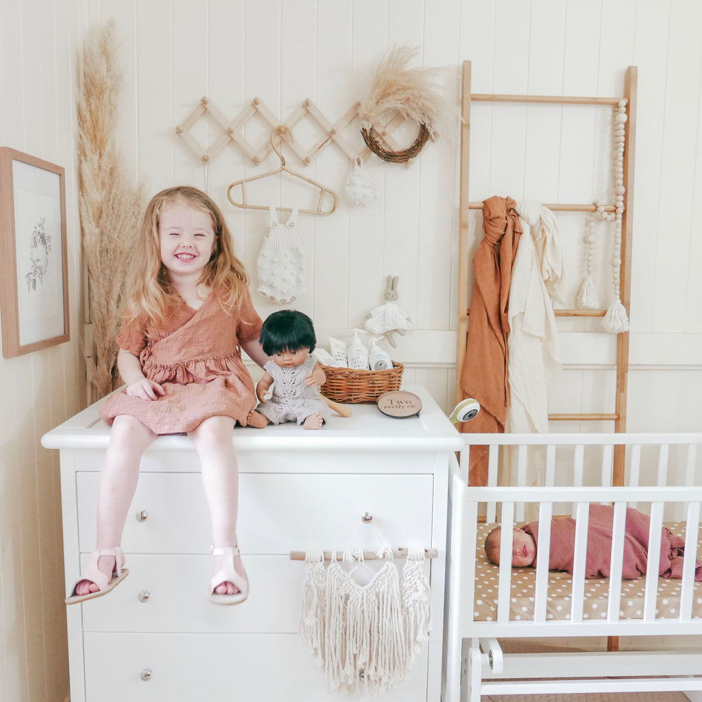 Toddler on Chest of Drawers