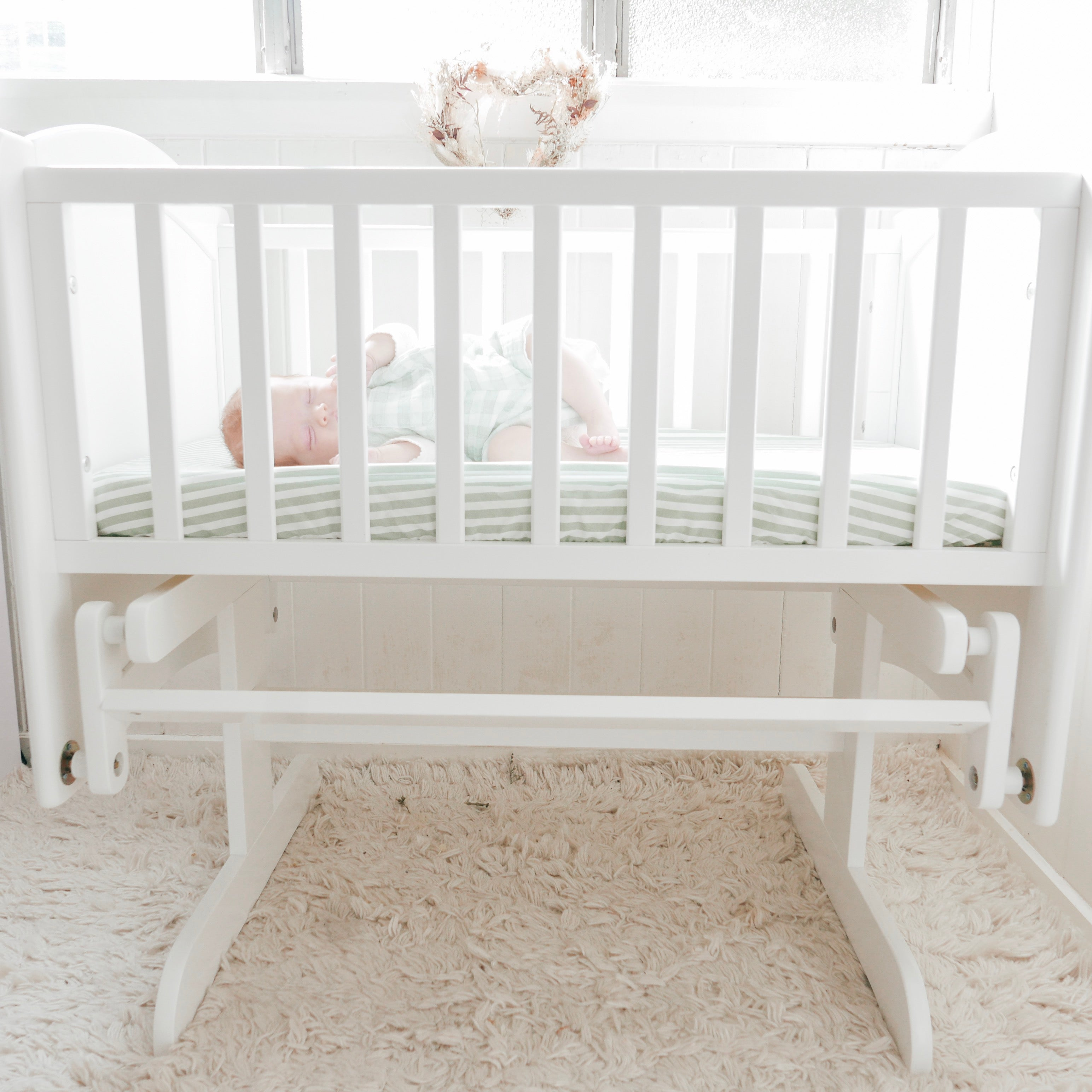 Newborn in Rocking Cradle showing size