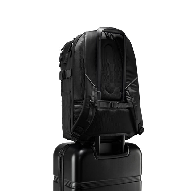 Speck Travel Business Backpack - Black - Rear Pass-Through Sleeve on Luggage View