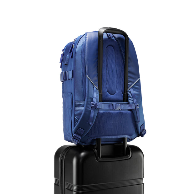 Speck Travel Business Backpack - Macaw Blue - Rear Pass-Through Sleeve on Luggage View