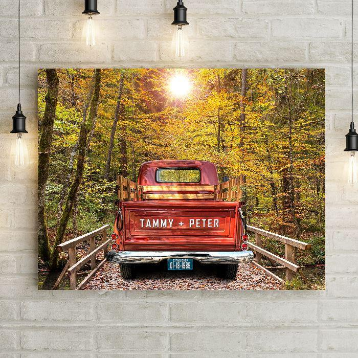 Custom Vintage Truck Wall Art Canvas Print with Personalized Couple Names on Truck Tailgate and Wedding Date on License Plate. Choose Blue, Green, or Antique Red Vintage Truck Canvas parked on a country road over a bridge through the woods on this custom canvas wall decor. Large wall art makes a Beautiful Custom Anniversary Gift or Personalized Wedding Gift.