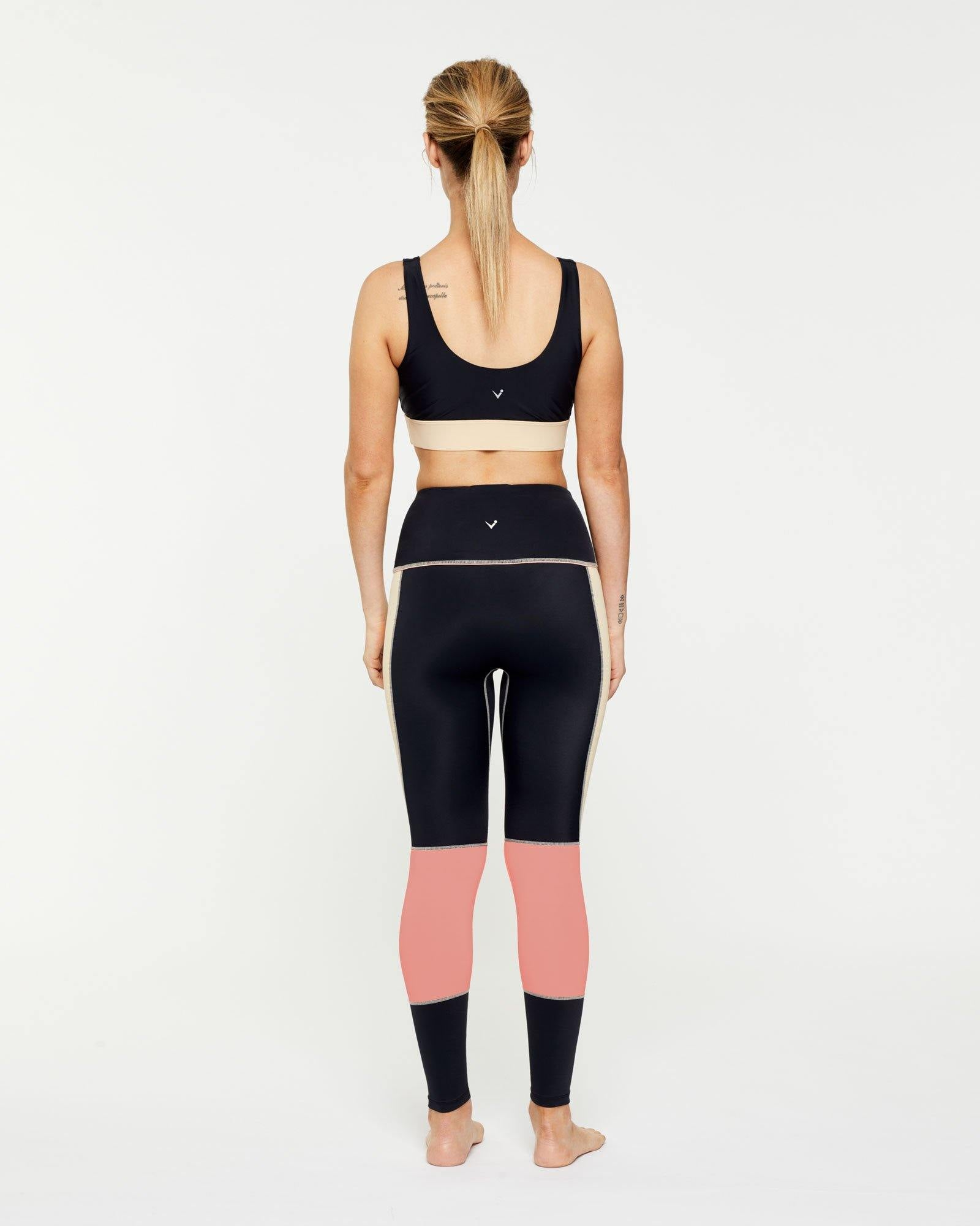 WARRIOR GRACILIS 7/8 HIGH WAISTED LEGGING BLACK WITH CONTRAST PANELS WORN WITH PECTORALIS BRA TOP, BACK VIEW