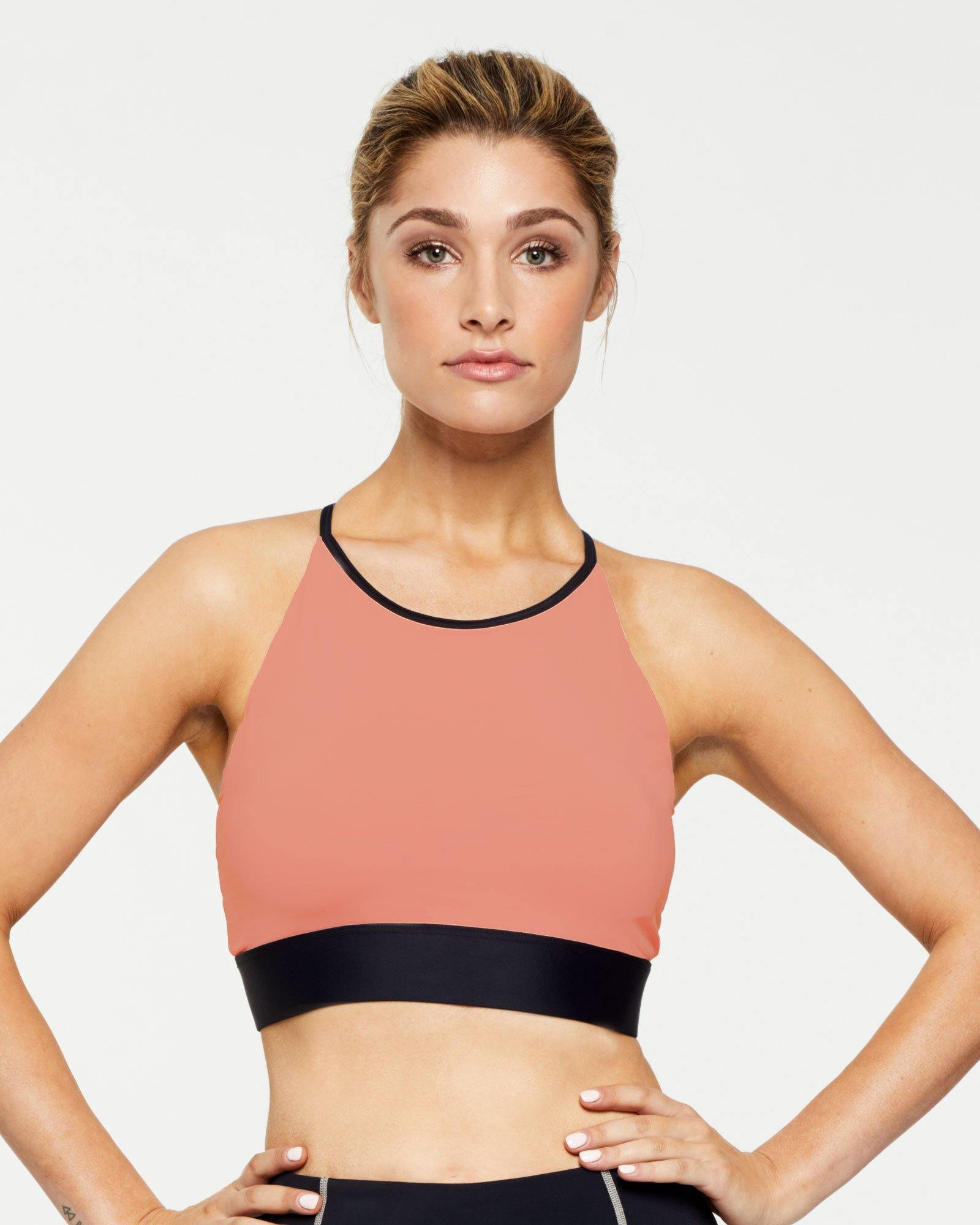 Warrior Trapezius Halter Crop Top peach with contrast black binding, front view