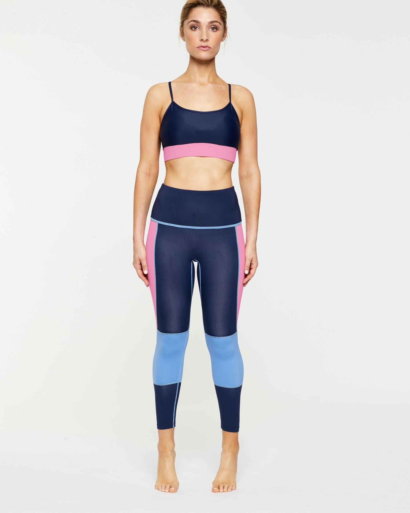 Femininely GRACILIS 7/8 HIGH WAISTED LEGGING Navy Blue WITH CONTRAST PANELS Sky blue and peony pink work with Infraspinatus active bra top, front VIEW, for pilates, barre, yoga, dance, gym-workouts
