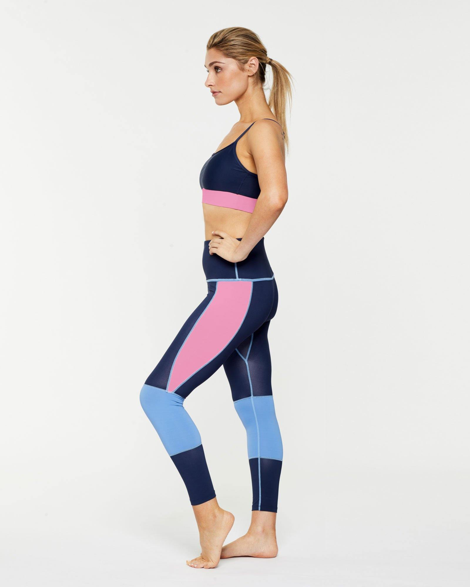 Femininely GRACILIS 7/8 HIGH WAISTED LEGGING Navy Blue WITH CONTRAST PANELS Sky blue and peony pink work with Infraspinatus active bra top, side VIEW, for pilates, barre, yoga, dance, gym-workouts