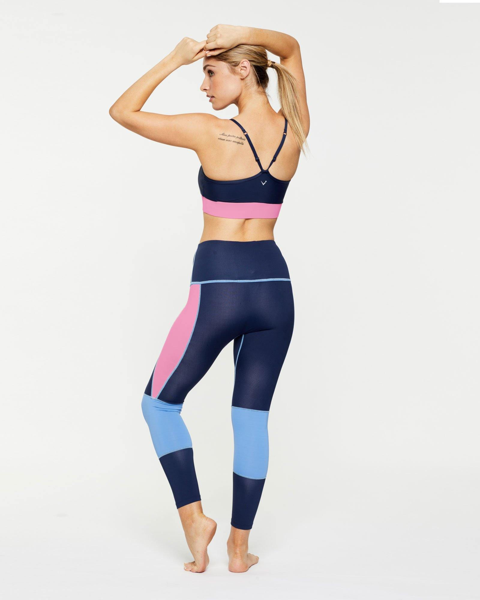 Femininely GRACILIS 7/8 HIGH WAISTED LEGGING Navy Blue WITH CONTRAST PANELS Sky blue and peony pink work with Infraspinatus active bra top, back VIEW, for pilates, barre, yoga, dance, gym-workouts